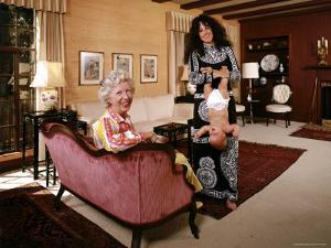 Grace Slick Holding Her Daughter Upside Down by the Ankles by John Olson