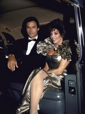 Actors Michael Nader and Joan Collins Sitting in a Car by John Paschal