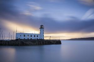A long exposure photograph of Scarborough Lighthouse shortly after sunrise, Scarborough, North York by John Potter
