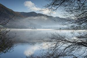 Dawn light and transient sunlit mist over Wall Holm Island on Ullswater, England by John Potter