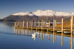 Derwent Water and snow capped Skiddaw from Lodor Hotel Jetty, Borrowdale, Lake District National Pa by John Potter
