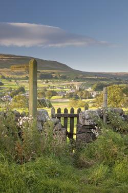 Footpath signpost and gate leading to Hawes village in Wensleydale, The Yorkshire Dales, England by John Potter
