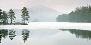 Lochan Eilein in Mid-Winter, the Loch Is Frozen Over by John Potter