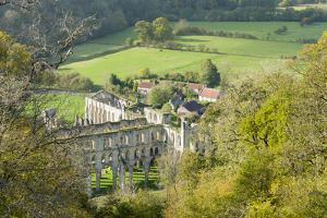 Rievaulx Abbey and remote village near Helmsley in North Yorkshire, England, United Kingdom, Europe by John Potter