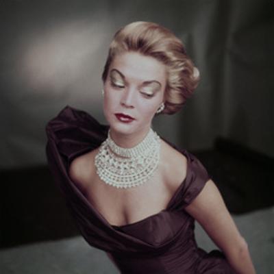 Model Jean Patchett Wearing Golden Brown Open Neck Satin Evening Dress by John Rawlings