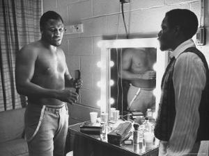 Boxer Joe Frazier Dressing During Training for a Fight Against Muhammad Ali by John Shearer