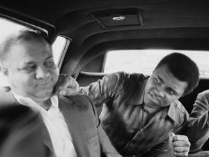 Boxer Muhammad Ali Clowning Around with His Trainer Bundini Brown by John Shearer