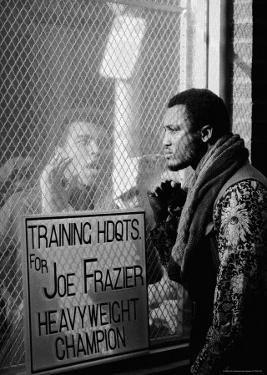 Boxer Muhammad Ali Taunting Boxer Joe Frazier During Training for Their Fight by John Shearer