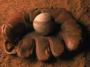 Baseball Glove with Ball on Dirt by John T^ Wong