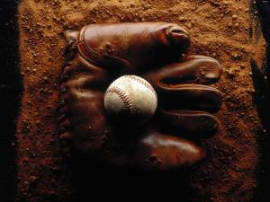 Baseball in Antique Glove by John T. Wong