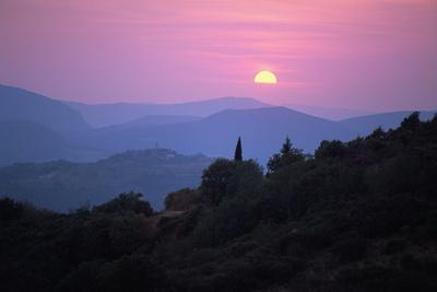 View of Tuscan Hill Top Town with Setting Sun, Tuscany, Italy, Europe
