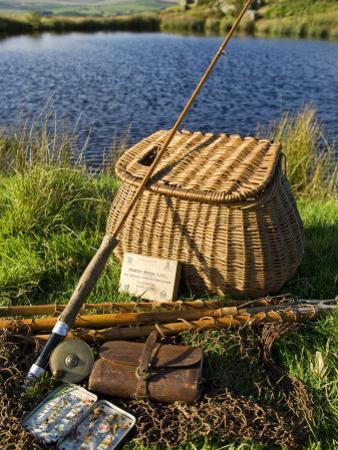 A Split-Cane Fly Rod and Traditional Fly-Fishing Equipment Beside a Trout Lake in North Wales, UK by John Warburton-lee