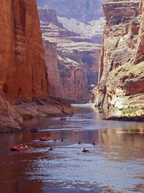 Arizona, Grand Canyon, Kayaks and Rafts on the Colorado River Pass Through the Inner Canyon, USA by John Warburton-lee