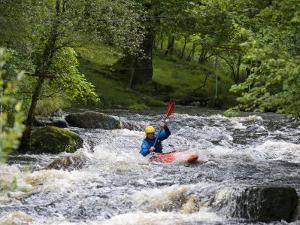 Gwynedd, Bala, White Water Kayaking on the Tryweryn River at the National Whitewater Centre, Wales by John Warburton-lee