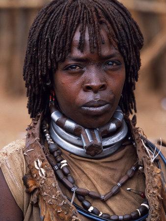Hamar Woman in Village Square of Dimeka, Married Women Wear Two Heavy Steel Necklaces, Ethiopia