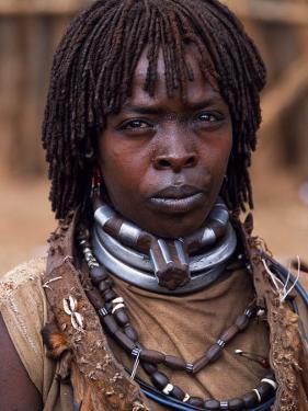 Hamar Woman in Village Square of Dimeka, Married Women Wear Two Heavy Steel Necklaces, Ethiopia by John Warburton-lee