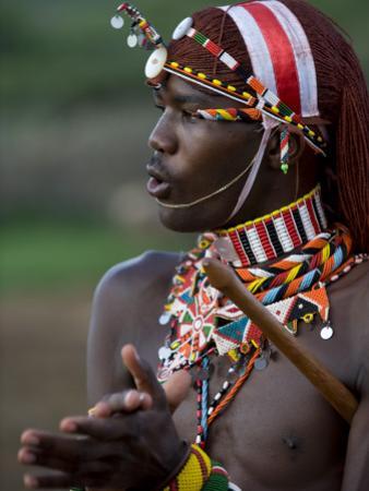 Kenya, Laikipia, Ol Malo; a Samburu Warrior Sings and Claps During a Dance by John Warburton-lee
