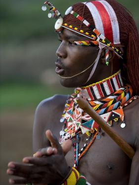 Kenya, Laikipia, Ol Malo; a Samburu Warrior Sings and Claps During a Dance by John Warburton-lee