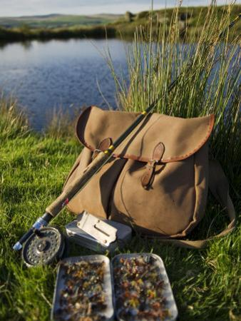 Wales, Conwy, A Trout Rod and Fly Fishing Equipment Beside a Hill Lake in North Wales, UK by John Warburton-lee