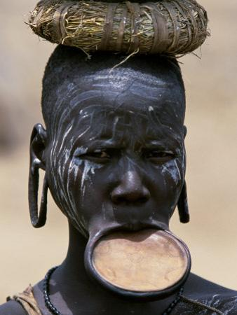Woman of the Mursi Tribe, Her Clay Lip Plate Shows That She Is Married, Ethiopia by John Warburton-lee