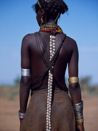 Young Dassanech Girl Wears Hair Partially Braided, Coated in Animal Fat and Ochre, Ethiopia by John Warburton-lee