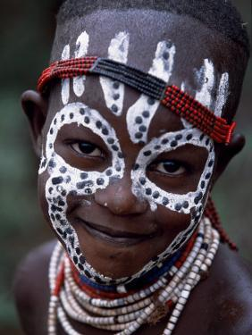Young Karo Girl Shows Off Her Attractive Make Up, Omo River, Southwestern Ethiopia by John Warburton-lee