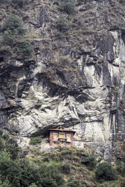 An Old Religious Building Built into the Side of a Cliff in the Sagarmatha National Park by John Woodworth