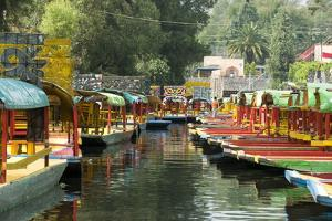 Colourful Boats at the Floating Gardens in Xochimilco by John Woodworth