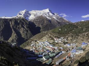The Town of Namche Bazaar with the Kongde Ri (Kwangde Ri) Mountain Range in the Background by John Woodworth