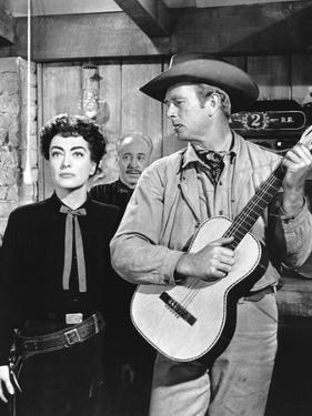 JOHNNY GUITARE, 1954 directed by NICOLAS RAY Joan Crawford and Sterling Hayden (b/w photo)