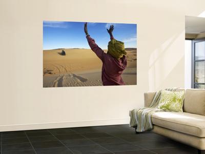 Tuareg Man Guiding 4Wd Car Through Soft Sand Dune