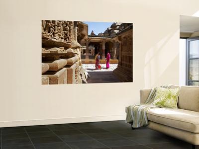 Women Walking Through Jain Temple
