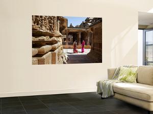 Women Walking Through Jain Temple by Johnny Haglund