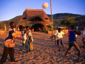 People Playing Volleyball Outside Indaba Bar, Cape Maclear, Malawi by Johnson Dennis
