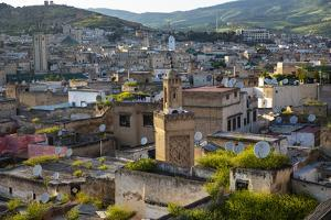 Fez, Morocco. Ancient city of Fez, its mosques and tile roofs by Jolly Sienda