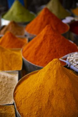 Fez, Morocco. Colorful ground spices tower shaped, farmers market by Jolly Sienda