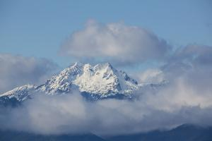 Hood Canal, Washington State. Fresh snow and pastel clouds surround the Brothers Mountain by Jolly Sienda