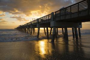 Juno Beach, Florida. Juno Beach Pier at sunrise with high surf by Jolly Sienda