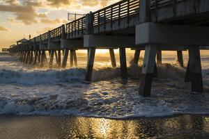 Juno Beach, Florida. Man watching high surf from the pier at Juno Beach by Jolly Sienda