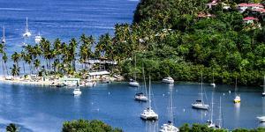 Marigot Bay, St. Lucia, Caribbean. marina, boats, palm trees, cove by Jolly Sienda