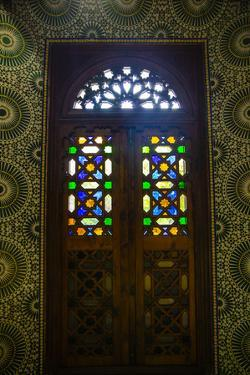 Marrakech, Morocco. Moroccan stained glass in wooden door by Jolly Sienda