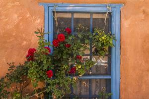 Santa Fe, New Mexico. Blue painted lattice wooden window by Jolly Sienda