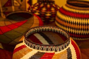 Santa Fe, New Mexico. Colorful woven, geometric, folk baskets by Jolly Sienda