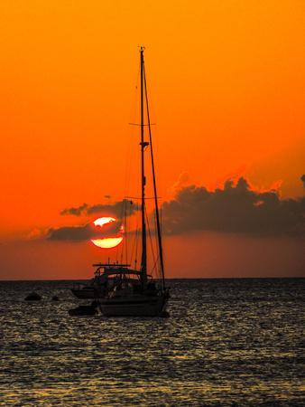 Seven Mile Beach, Grand Cayman. Sailboat on the Carribean at sunset.