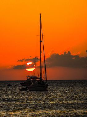 Seven Mile Beach, Grand Cayman. Sailboat on the Carribean at sunset. by Jolly Sienda