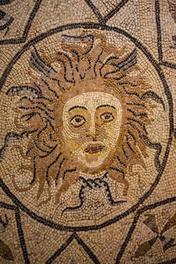 Volubilis, Morocco. Ancient sun face mosaic tile by Jolly Sienda