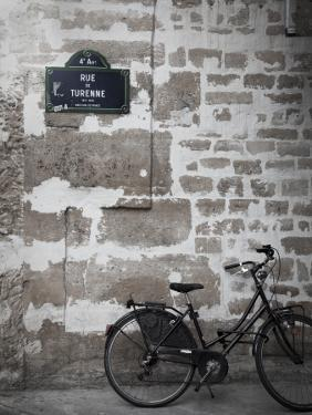 Bicycle and Street Sign, Paris, France by Jon Arnold