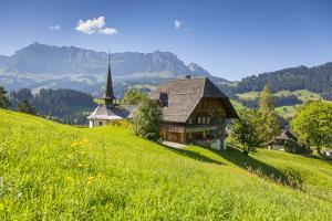 Church and Farmhouse in a Village in the Emmental Valley, Berner Oberland, Switzerland by Jon Arnold