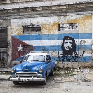 Classic American Car and Cuban Flag, Habana Vieja, Havana, Cuba by Jon Arnold