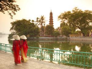 Girls Wearing Ao Dai Dress, Tran Quoc Pagoda, West Lake (Ho Tay), Hanoi, Vietnam by Jon Arnold
